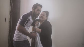 An elderly woman asks for her husband as she is evacuated from a building in Akcakale, Syria (LaPresse)