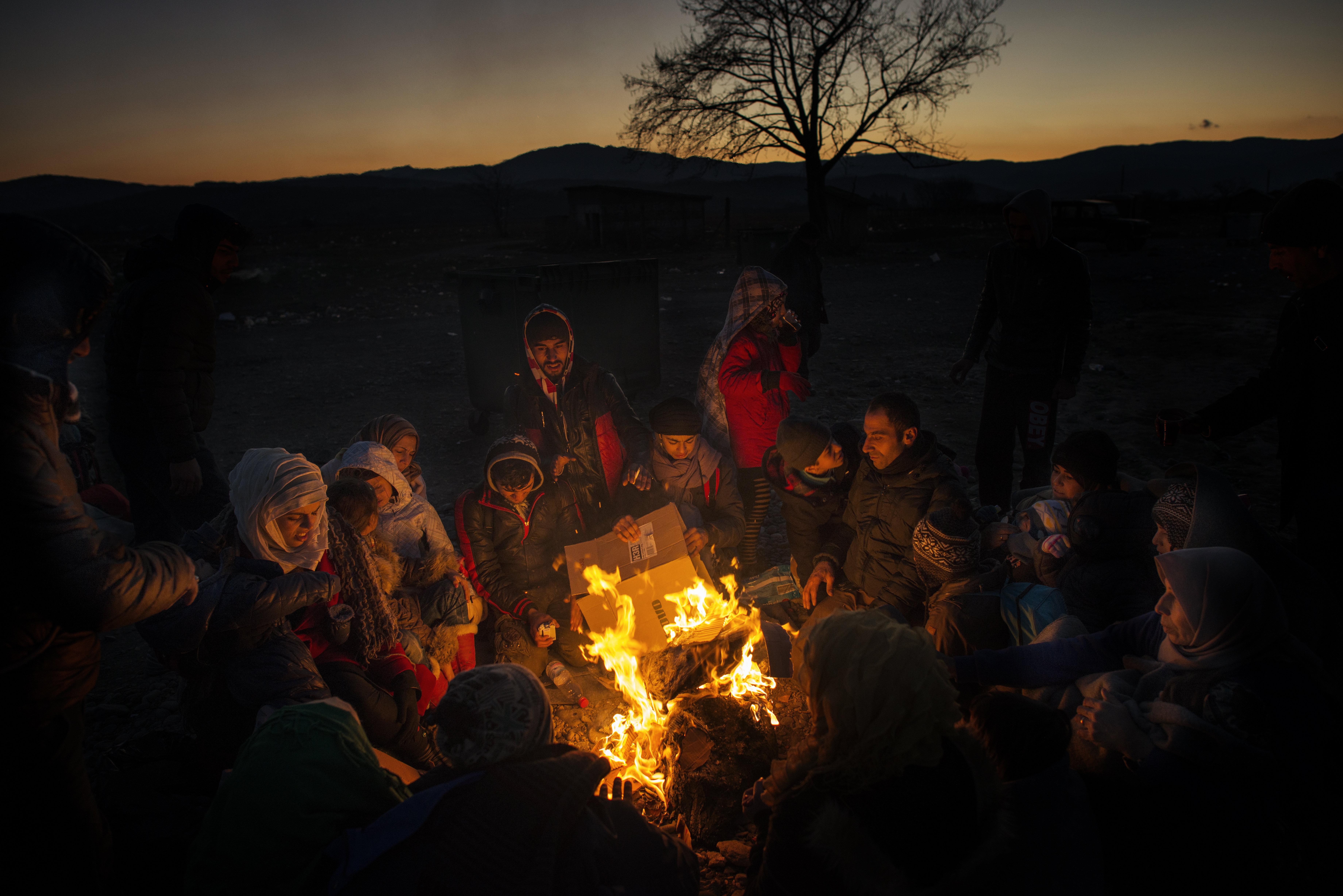 Migranti in fuga dall'Isis (LaPresse)