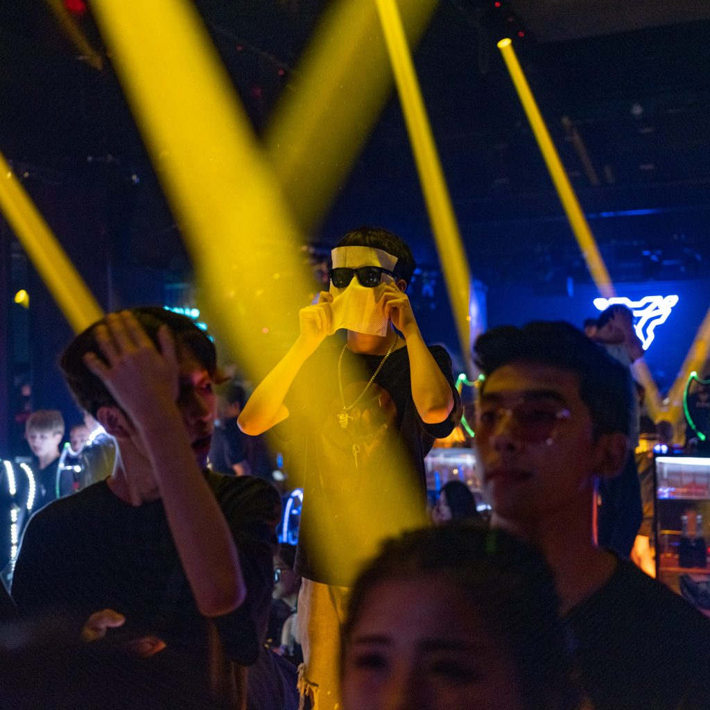 A guy on stage at an hip hop club in Wuxi