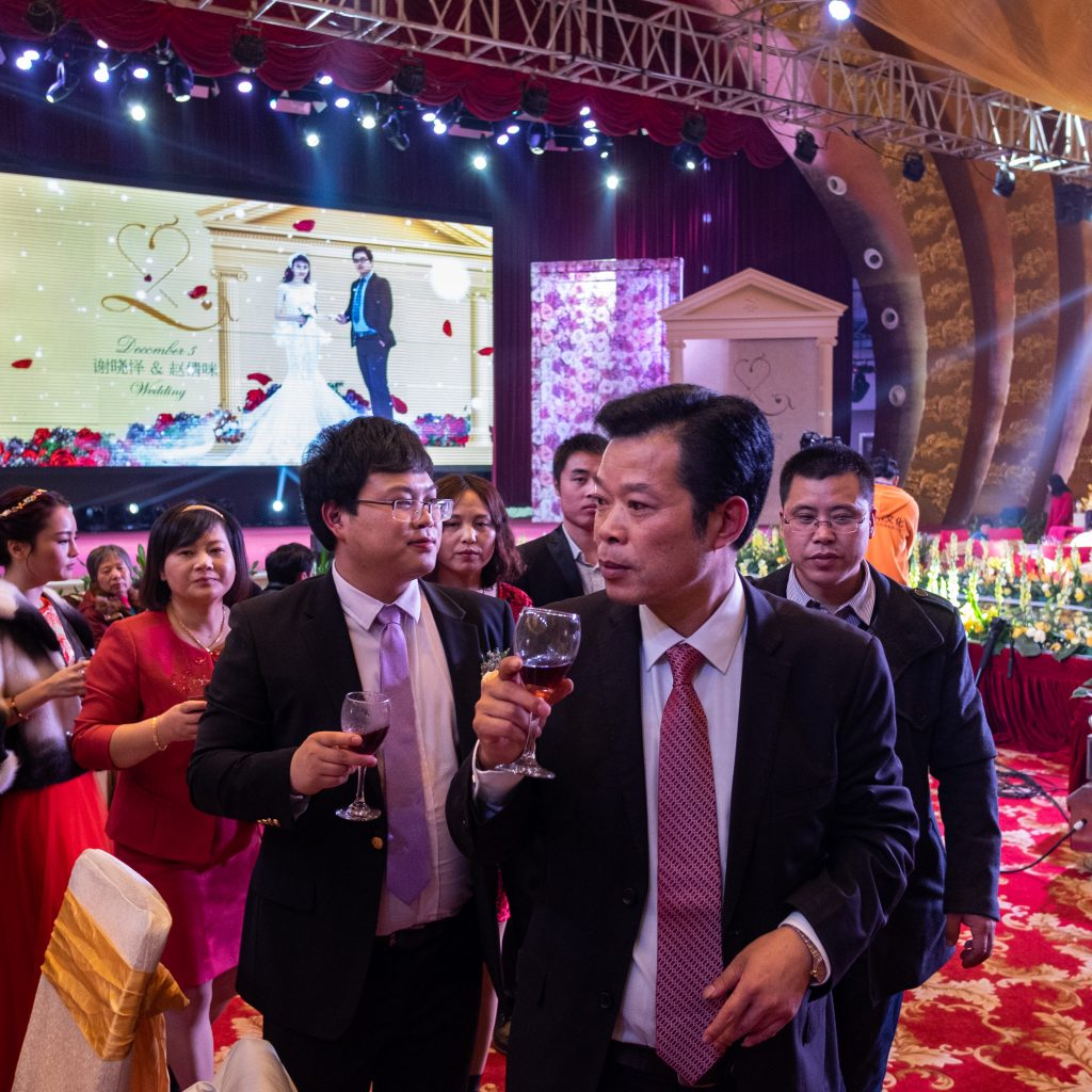 A wedding in a large reception hall in Huaxi